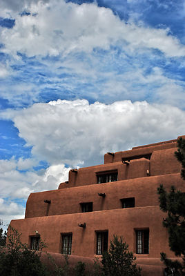 NM blue sky stucco hotel