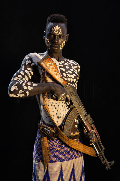 Portrait of a Kara Tribesman with an AK-47