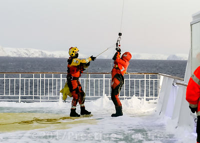 Winchman and Volunteer lowered on to the decks of fast moving ship in the Norwegian Sea