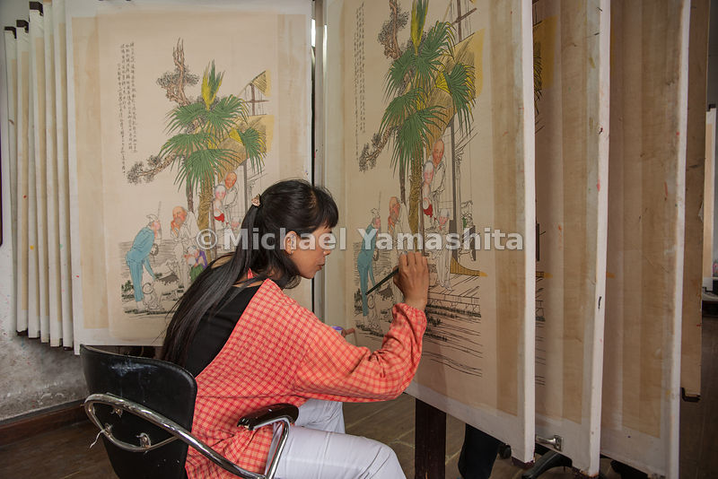 New Year painting in Tianjin Old Town. Once the most famous for producing this folk art, now mass produced for tourists. Combines wood block printing plus painting. Popular to hang at New Year.