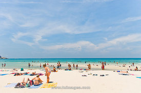 tourists at Haad rin beach of koh phangan thailand