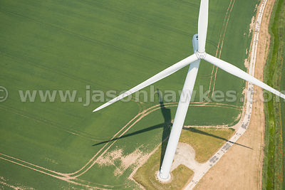 Aerial view of wind turbine in fields, United Kingdom