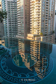 Reflection of a building in the rooftop pool at The Muse Hotel in Bangkok, Thailand.
