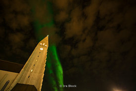The Aurora Borealis or Northern Lights in the sky over the Hallgrímskirkja Cathedral in Reykjavik, Iceland. It is a Lutheran church and the largest church in Iceland.
