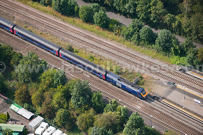 Aerial view of train on railway / tracks