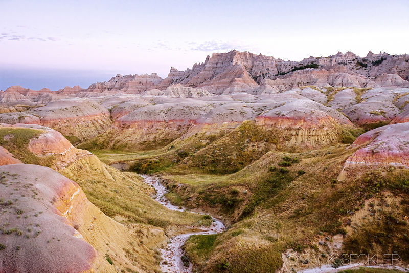 stream runs through a valley in the Badlands