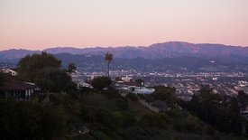 Wide Shot: Sunset Over Hollywood Sign, Mountain Ridges, & L.A. Homes