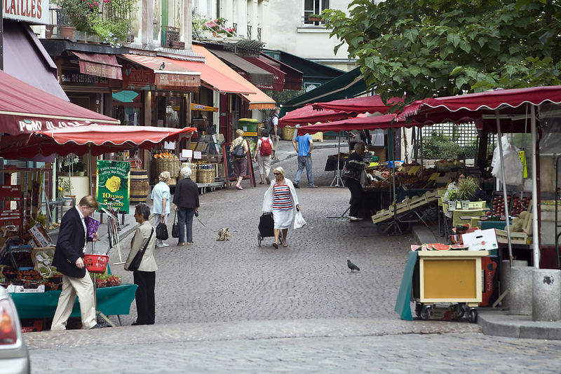 France - Paris - Shoppers walk through the market on the Rue Mouffetard.