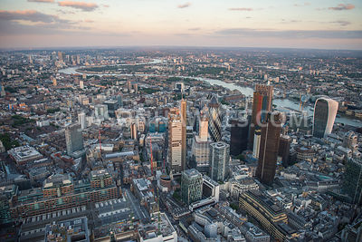 Dsk aerial view over the City of London and Liverpool St Station, looking East, London. 30 St Mary Axe, 94 Middlesex St, 110 Bishopsgate, 199 Bishopsgate, City of London, EC2N, Heron Tower, Liverpool street station, london, Natwest Tower, Swiss Re Building, tower 42, Wormwood Street