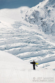 Snowboarder and crevasses