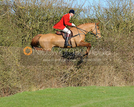 Ashley Bealby jumping a hedge near Knossington village