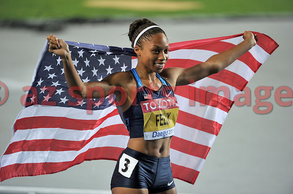 Allyson Felix holds the American flag after she wins the Bronze medal.Allyson Felix 22.42sec. third place at the Iaaf World Championships 2011
