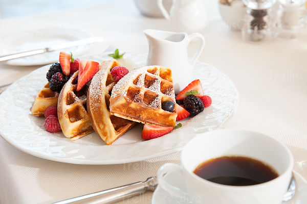 Delicious waffles and berries with coffee