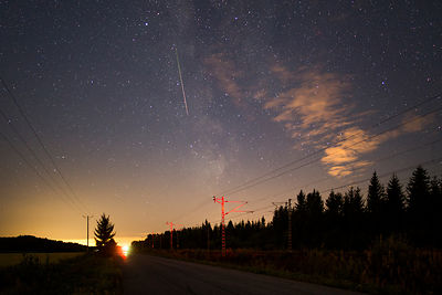Lone Perseid meteor above railroad track in Southern Finland during the annual Perseid meteor shower on August 14 2018.