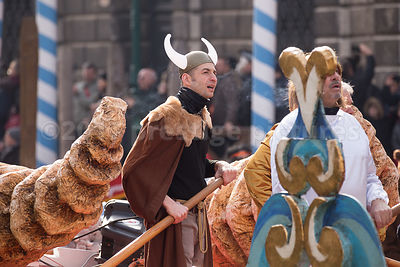 Man wearing a Viking horned helmet in the Venice Carnival Water Parade on the Rio di Cannaregio Canal