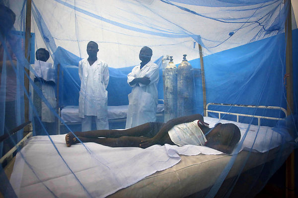 Ivory Coast, Abidjan. general hospital in Port-Bouet, Emergency Department. Aboubakar, malaria patient is protected by a mosquito net.