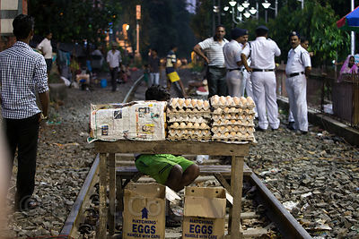 Man selling eggs on the railway, Babughat, Kolkata, India