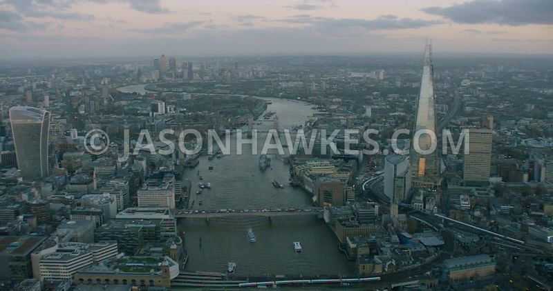 Aerial footage of the Shard and the skyscrapers of the City of London