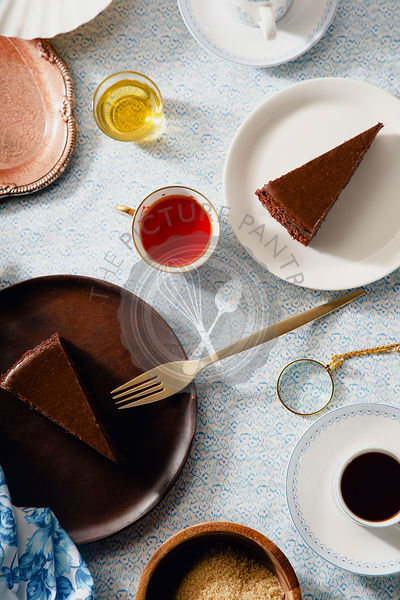 Overhead image of tea party with chocolate cheesecake