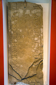 Post Norman Grave Stone with the inscription in Welsh EV GORWEDD GORPH ELI[ZABETH] .. HON V GLADDWYD Margam Stone Museum, Wales