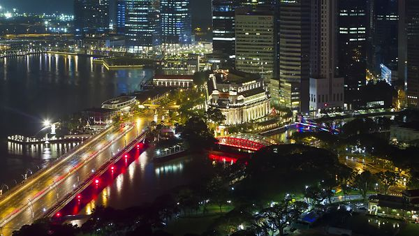 Bird's Eye: Singapore River In Neon Lights Of The Evening