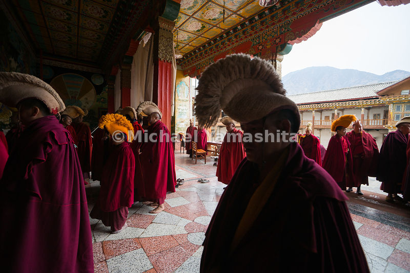 Buddhist monks of the yellow hat sect file into the centuries-old Dongzhulin Monastery, which sits near the scenic mountain village of Shiyi. Traditionally, the Dalai Lama—Tibetan Buddhism's spiritual head—comes from the yellow hat sect.