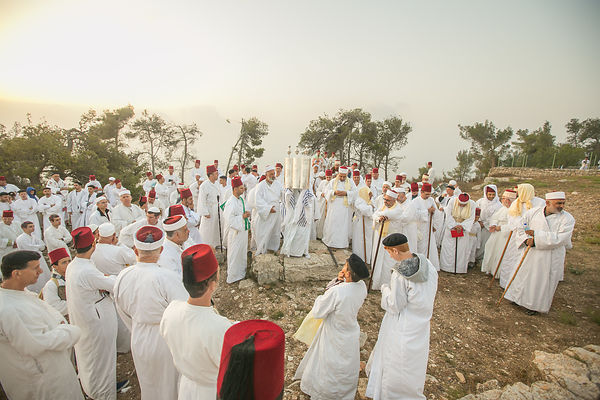 Samaritan as they pray celebrate the Shavuot festival at dawn on Mount Gerizim