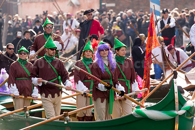 Men & Women in green and brown Woodland Costumes in the Venice Carnival Water Parade on the Rio di Cannaregio Canal