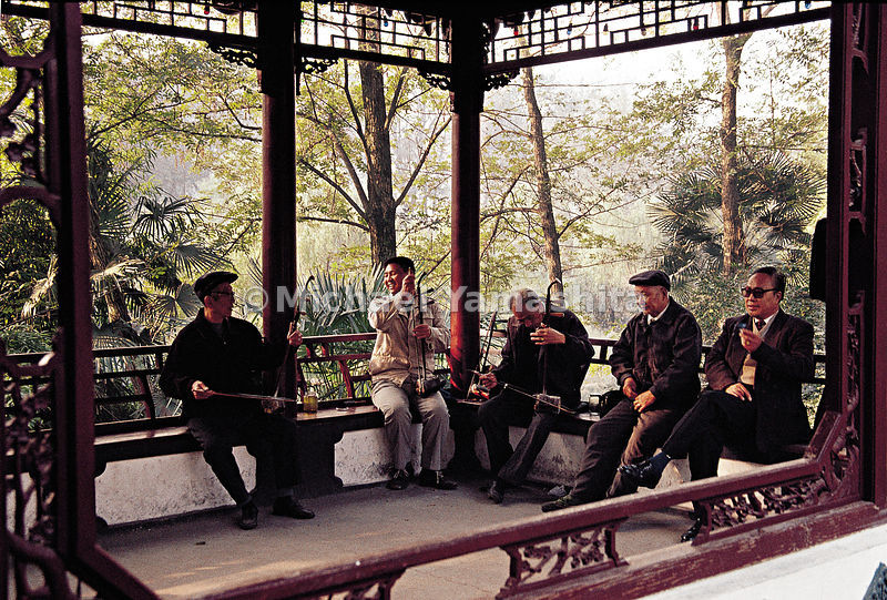Chinese opera enthusiasts rehearse in a pavilion on the canal built by Emperor Qian Long.