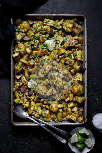 Vegetable bake with potato, cauliflower and tofu, baked on a silver tray