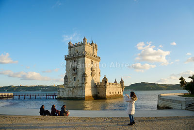 Torre de Belém (Belem Tower), a UNESCO World Heritage Site built in the 16th century in Portuguese Manueline Style at twilight. It was designed by the architect Francisco de Arruda. The River Tagus Estuary in the background. Lisbon, Portugal