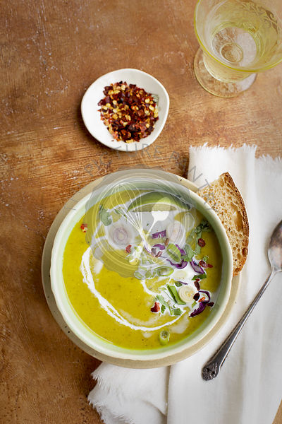 Red Lentil Cilantro Coconut Soup served with bread.