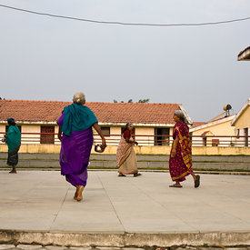 Elders walk through the amphitheatre after morning worship at the Tamaraikulum Elders village, Tamil Nadu