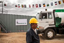 An employee attends the ceremony of the first test sales of Tsimiroro's crude oil, western Madagascar, on June 18, 2014. Tsimiroro is a large deposit of heavy oil exploited by the Madagascar Oil company.