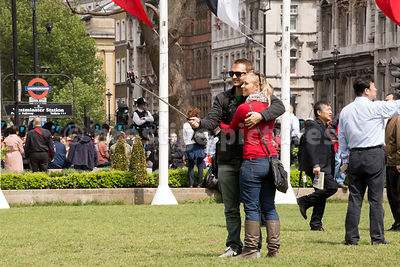 Hugging Couple using a Selphie stick to take a Picture of Themselves