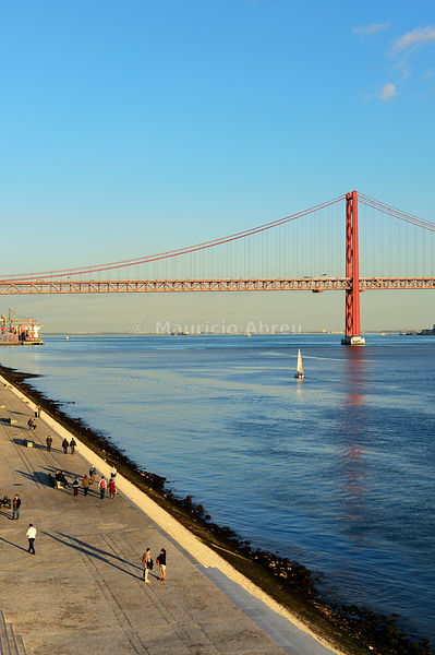 The pedestrian way along the Tagus river in Belem district. Lisbon, Portugal