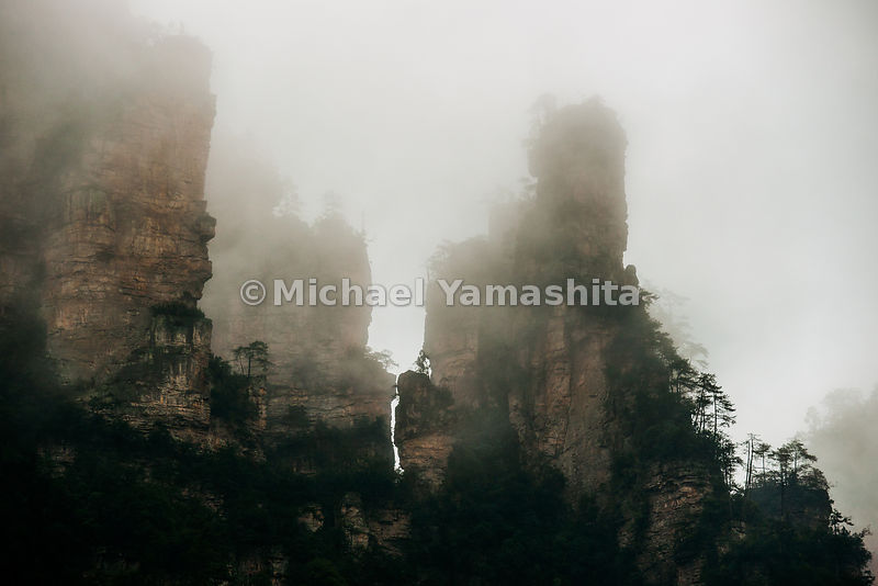Wulingyuan National Forest Park, China's oldest from 1982. Designated World Heritage site in 1992. 2004 received Geopark Status. 3000 sandstone pillars shrouded much of the time in mist make this the classical Chinese landscape painting. Pics taken along 10km train valley