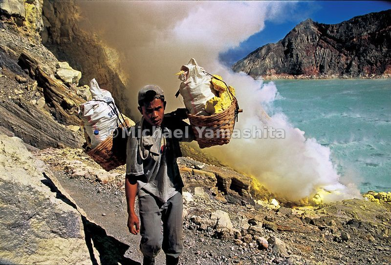 Workers carry loads of sulfur, some weighing up to 175 lbs (80 kg), making three trips in a ten-hour day to the top of the volcano.