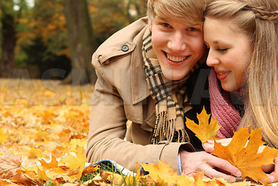 Young couple in love. Autumn Portraits with leaves.
