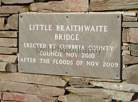 A plaque on the new stone bridge over Newlands Beck at Little Braithwaite in the English Lake District after the floods of 2009. UK.