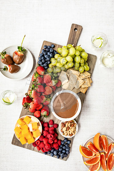 Cheese and fruit board with chocolate sauce