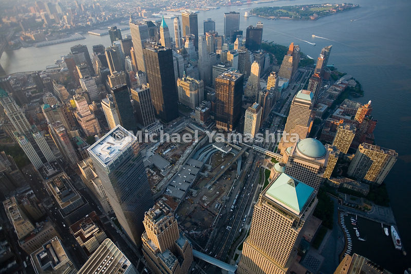 The gaping 16-acre space left after the destruction of the World Trade Center is a visible sign of dramatic impact of the terrorist attacks; plans are underway to rebuild the area, with the 415-meter Freedom Tower as its centerpiece.  Manhattan, New York City.