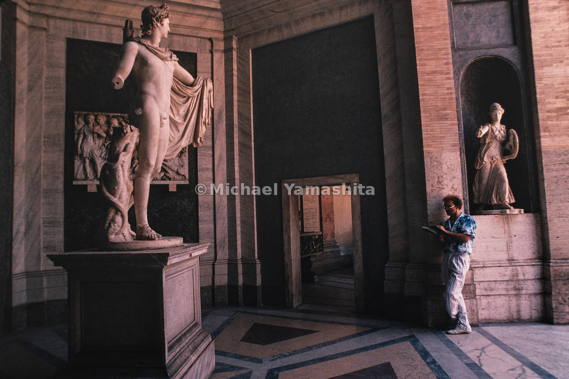 An artist draws sketches of the sculptures in the Vatican Museums. Italy, Rome, 1988.