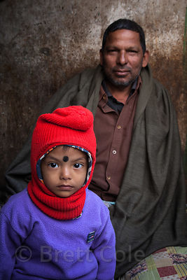 Portrait of a boy and his father in Howrah, India