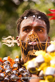 face with piercing at thaipusam festival in malaysia