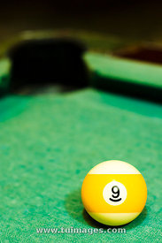 yellow striped billiard ball