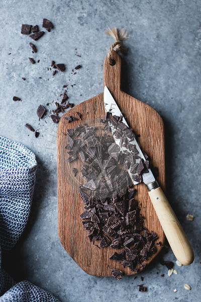 Chopped chocolate on a chopping board