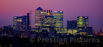 Cityscape of Canary Wharf Skyscrapers against a Purple Sky