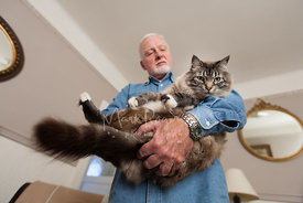 Older Man with White Beard Holding Silver Longhaired Cat