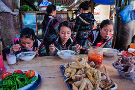 Black Hmong Girls Eating at Market
